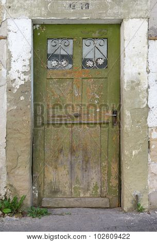 Old, green, weathered wooden door