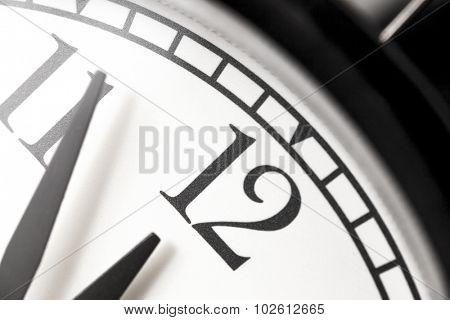 Photo alarm clock,arrow close to 12 hours