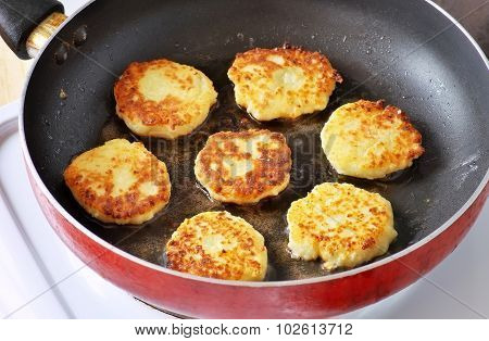Beautiful Golden Cheese Pancakes Fried In A Pan. Syrniki. Cottage Cheese Pancakes. Fritters Of Cotta