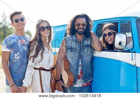 summer holidays, road trip, vacation, travel and people concept - smiling young hippie friends with guitar over minivan car