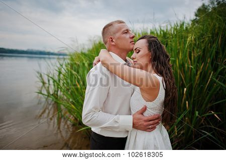 Couple At Lake On Water Near Bullrush