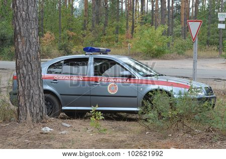 KIEV, UKRAINE - September 03, 2015: Ukrainian rescue and fireman team car Skoda Octavia in the forest.