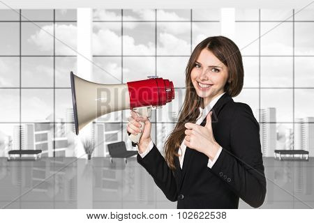 businesswoman with megaphone and thumbs up