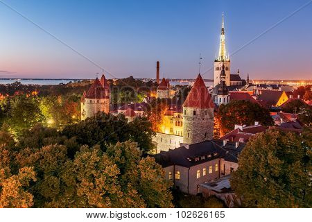 Old Tallinn, City Walls, Towers, Churches And Bay Of Tallinn By Night