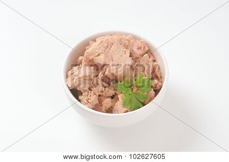 bowl of tuna chunks on white background