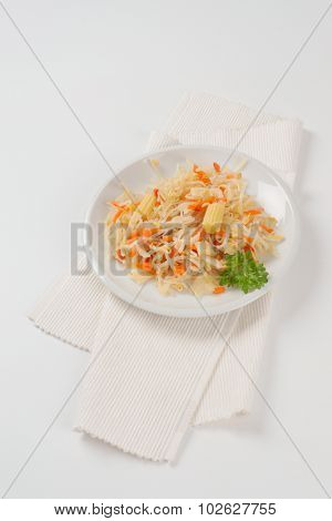 plate of carrot and bean sprouts salad on white place mat