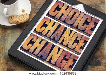 choice, chance and change word abstract  - 3 Cs in life concept  - text in letterpress wood type printing blocks on a digital tablet with a cup of coffee