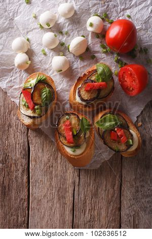 Sandwiches Crostini With Aubergine, Tomato And Cheese. Vertical Top View