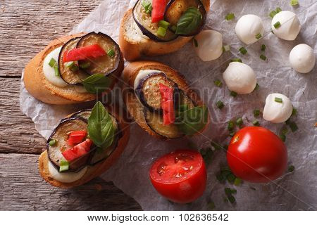 Crostini With Aubergine, Tomato And Cheese Close-up. Horizontal Top View