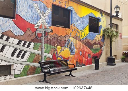 FORT COLLINS, CO, USA, JULY 22, 2012:  Alley in Fort Collins old town decorated by  a mural with local and music themes.