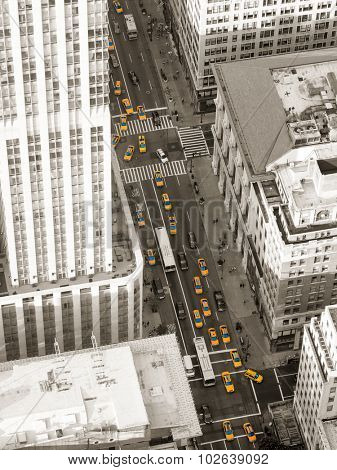 Aerial black and white view of New York City with lots of yellow cabs