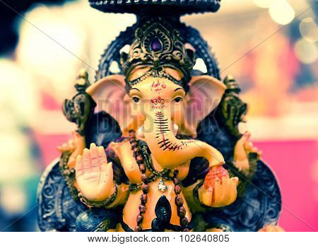 Yello Ganesh Elephant God In Hindusim Mythology In Rich King Pose With Multi-hands Emperor Crown And