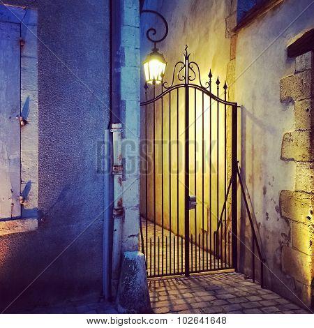 Iron Gate And Streetlight