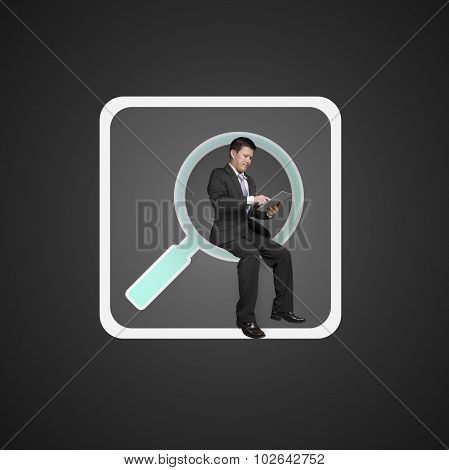 Businessman Sitting On Searching App Icon Using Smart Pad