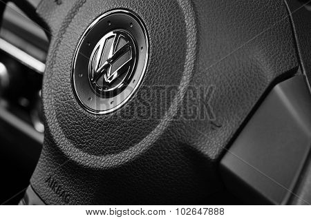 VW badge on a steering wheel