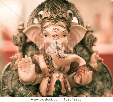 Ganesh Elephant God In Hindusim Mythology In Rich King Pose With Multi-hands Emperor Crown And Axe