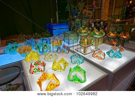 Elegant And Shiny Souvenirs Made Of Colored Glass Displayed For Sale