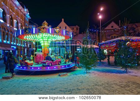 Little Kids Riding A Merry-go-round At The Traditional Christmas Market