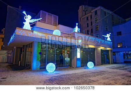Building Decorated With Illuminated Angel Figures And Shiny Balls