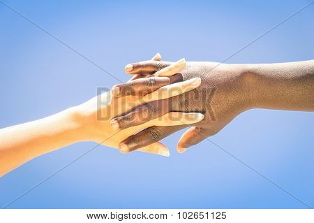 Interracial Human Hands Crossing Fingers For Friendship And Love - Concept Of Peace And Unity