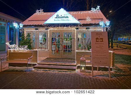 Illuminated Wooden Building Decorated For Christmas