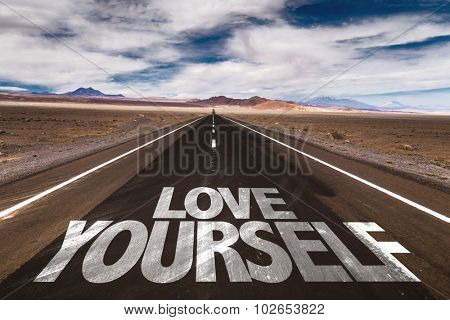 Love Yourself written on desert road