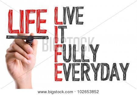 Hand with marker writing: Life Acronym