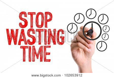 Hand with marker writing: Stop Wasting Time