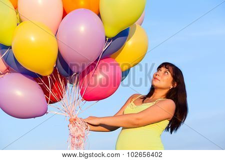 Beautiful Happy Young Pregnant Woman Girl Outdoors With Balloons On Sky Background
