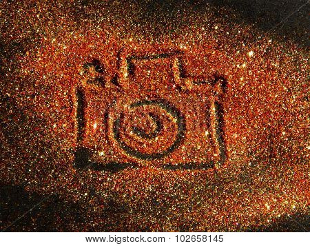 Blurry Photo Camera on golden and red glitter sparkle on black background