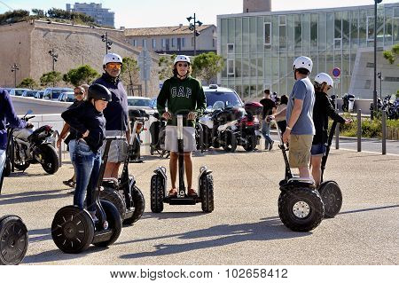 Tourist Group Moving Segway