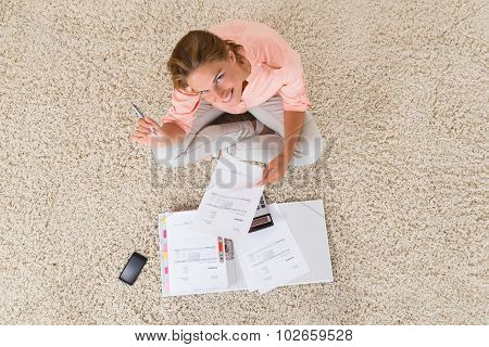 Woman Doing Calculation