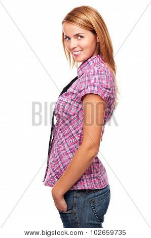 Young casual girl standing in profile and smiling in studio