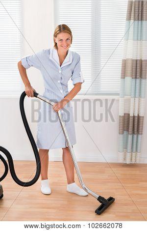 Female Maid With Vacuum Cleaner