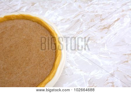 Pie Shell Filled With Pumpkin Pie Filling