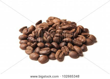 Heap Of Roasted Coffee Beans On White