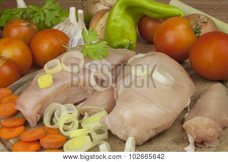 Fresh raw chicken fillet and vegetables prepared for cooking. Fresh raw chicken breasts.