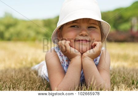 Little Adorable Girl In The Park