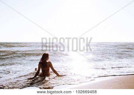 woman enjoy in sea water on sandy beach at Ada Bojana, Montenegro