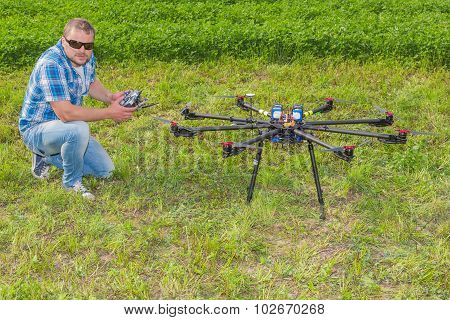 Man with multicopter on ground
