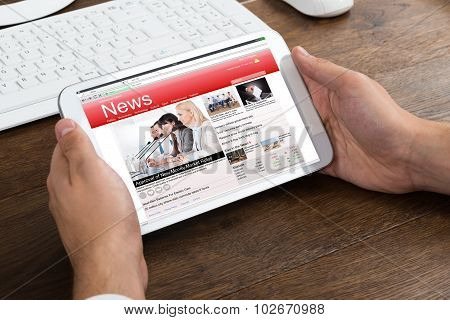 Businessperson Holding Mobile Phone Showing News