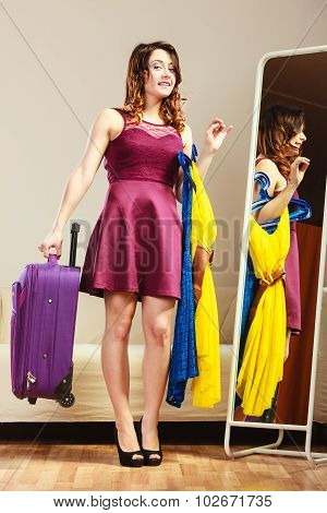 Woman With Packed Suitcase