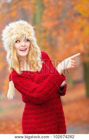 Woman In Winter Clothing Fur Cap