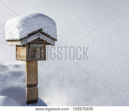 Wooden Mailbox In Winter