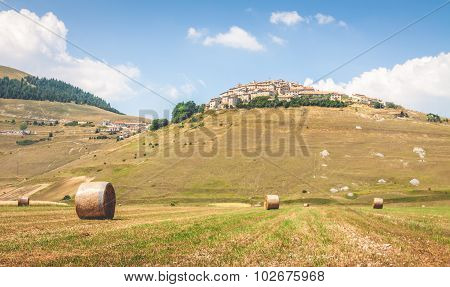 Hay Bails On The Field In Castelluccio Di Norcia, Italy