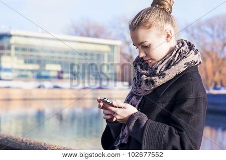 Communication Concept. Young Caucasian Teenage Girl Speaking On Cellphone.posing Outdoors In Trendy
