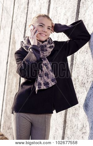 Youth And Communication Concept. Young Caucasian Teenage Girl Speaking On Cellphone.posing Outdoors