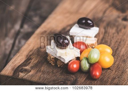 Camembert and olives with fresh cherry tomato