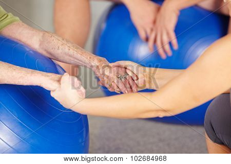 Hands of a senior woman in gym during rehab