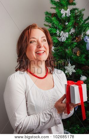 Mid age woman with gift box